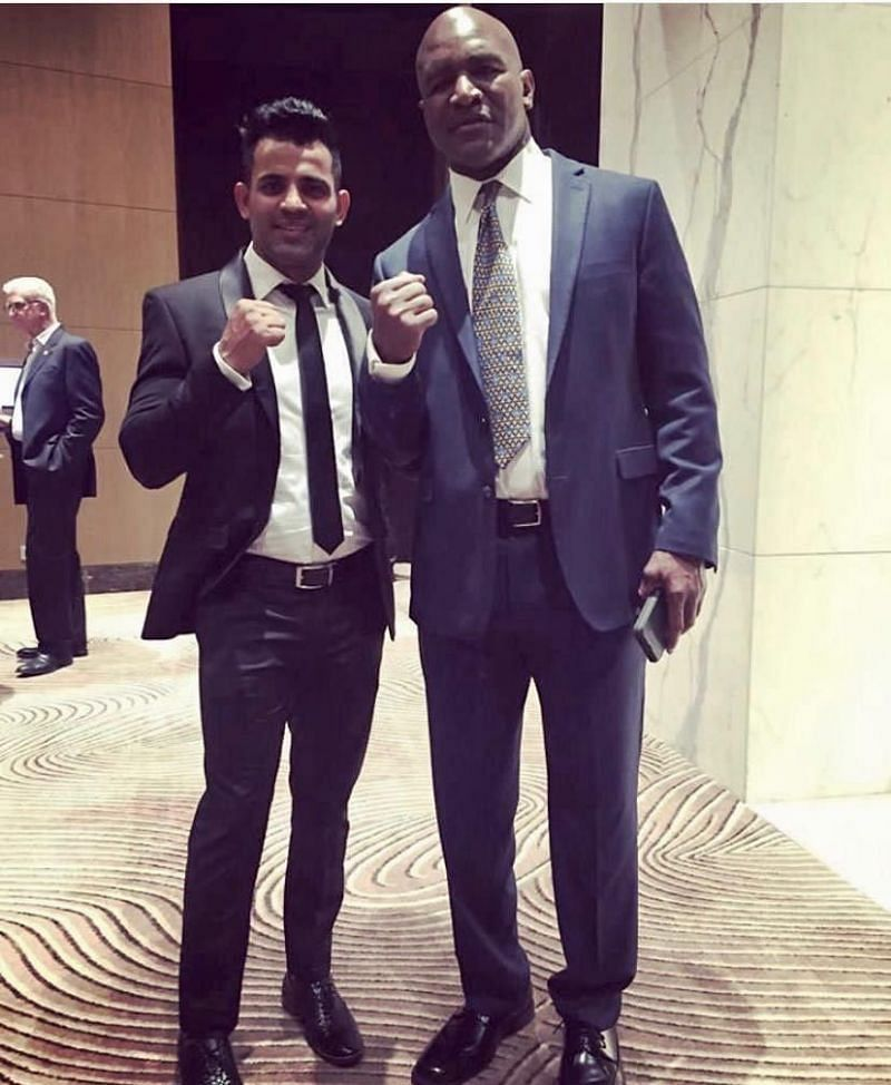 Mujtaba Kamal with professional boxing legend Evander Holyfield