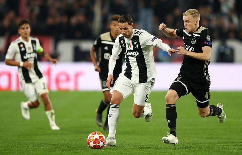 Mattia De Sciglio in action against Donny van de Beek of Ajax