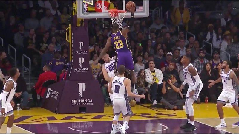 LeBron James dunks on an unfortunate Nemanja Bjelica