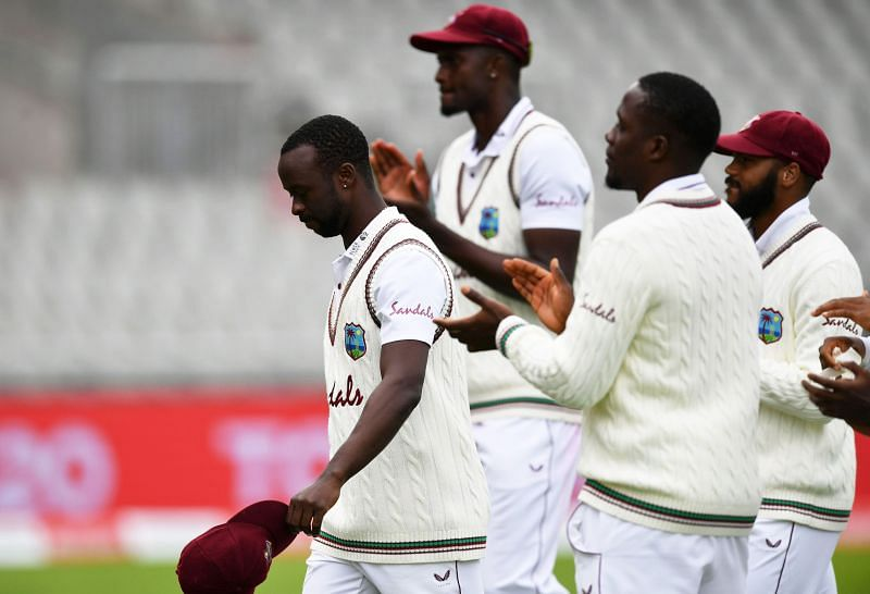 Kemar Roach leads his team off the field