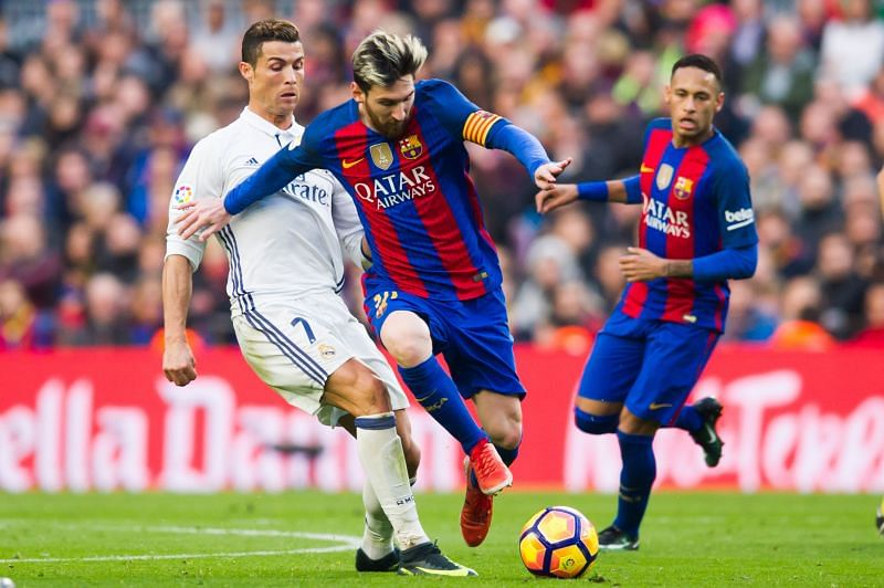 Lionel Messi (left-footed) and Cristiano Ronaldo (right-footed) duelling for the ball in an El Clasico