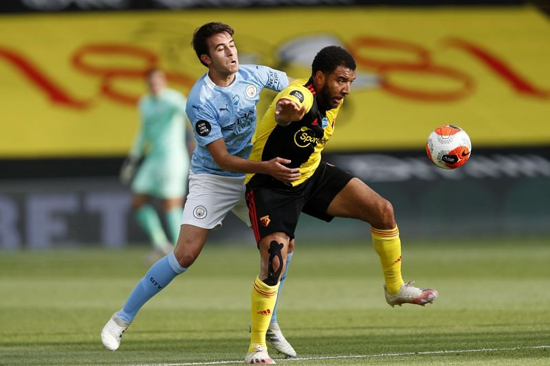 Eric Garcia tussles with Troy Deeney of Watford
