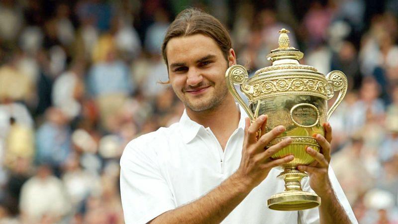 Roger Federer lifting his 1st Wimbledon title