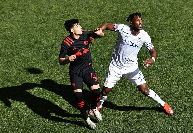 Brian White of New York Red Bulls and Kendall Waston of FC Cincinnati