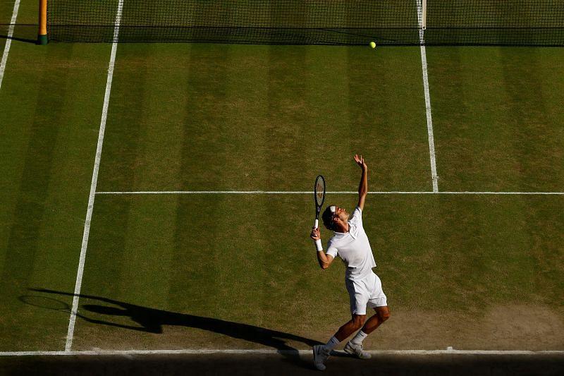 Roger Federer serves to Novak Djokovic in the Wimbledon 2014 final