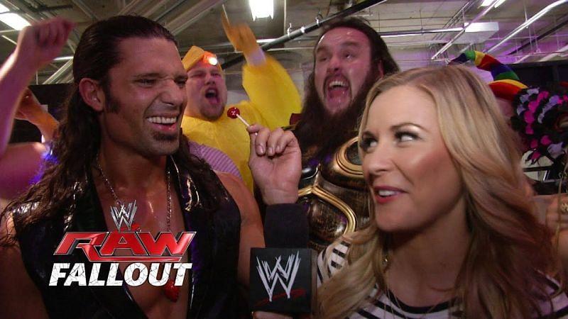 Adam Rose with Braun Strowman behind him