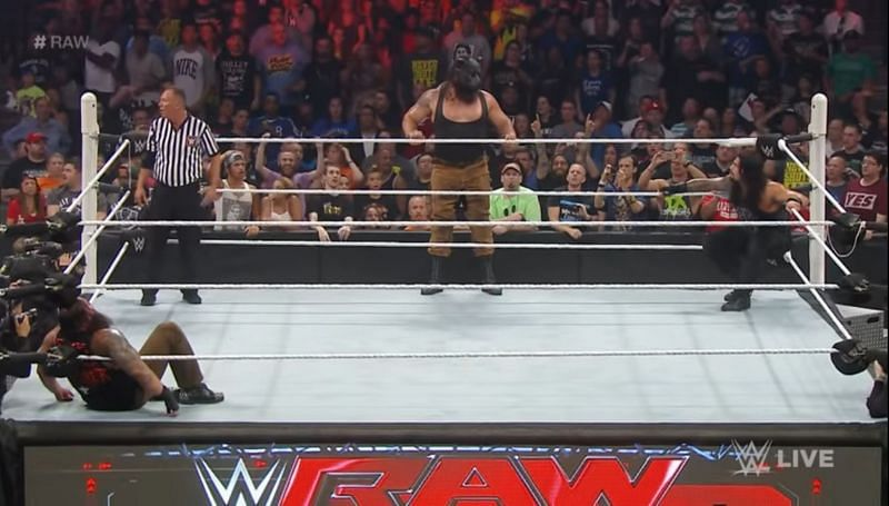 Braun Strowman debuted with Roman Reigns and Bray Wyatt in the ring.