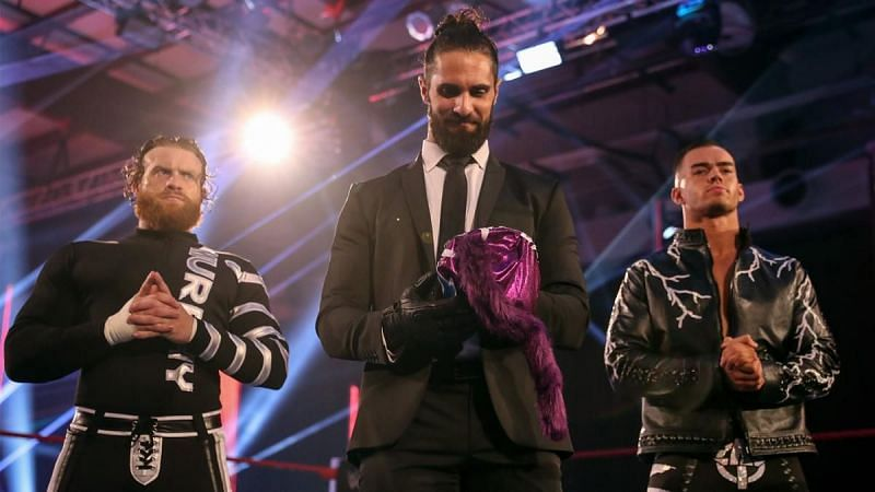 Seth Rollins with Murphy and Austin Theory