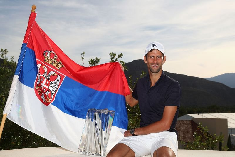 Novak Djokovic with the Serbian flag after winning the 2016 BNP Paribas Open in California