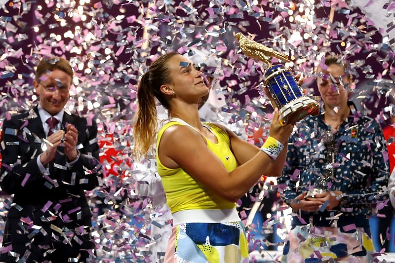 Aryna Sabalenka celebrates with the trophy at the Qatar Total Open 2020