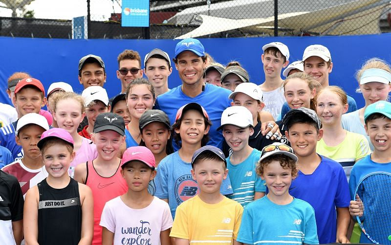 Rafael Nadal poses with young players from his academy