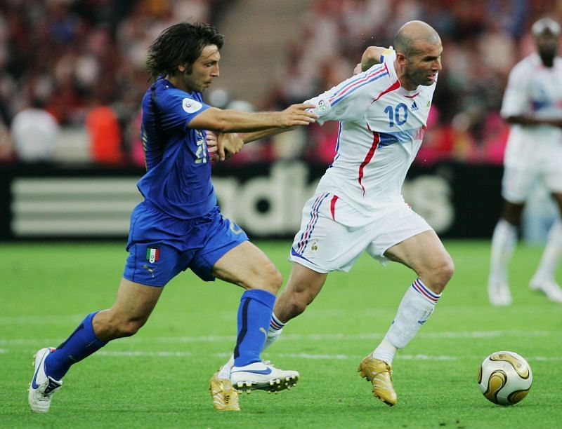 Zinedine Zidane pushes the ball past Andrea Pirlo during the 2006 FIFA World Cup final