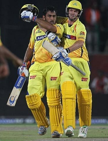 MS Dhoni (left) hit Irfan Pathan for two towering sixes in the final over of the game.