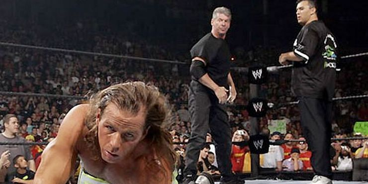 Shane and Vince McMahon ganging-up on Shawn Michaels