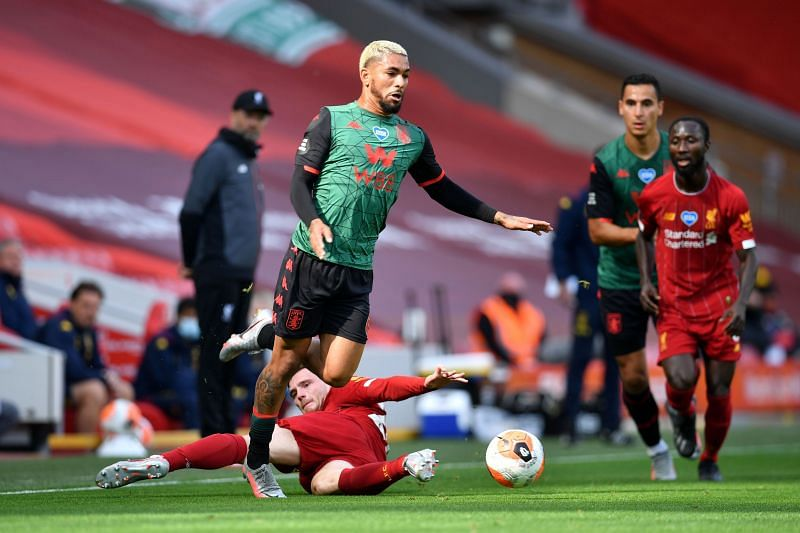 Douglas Luiz of Aston Villa is fouled by Andy Robertson of Liverpool.