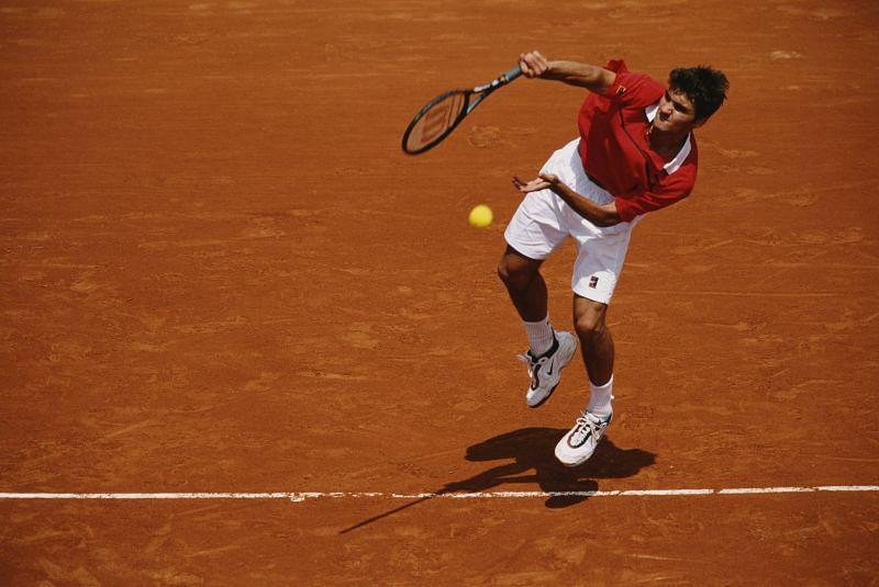 An 18-year-old Roger Federer serves at the French Open