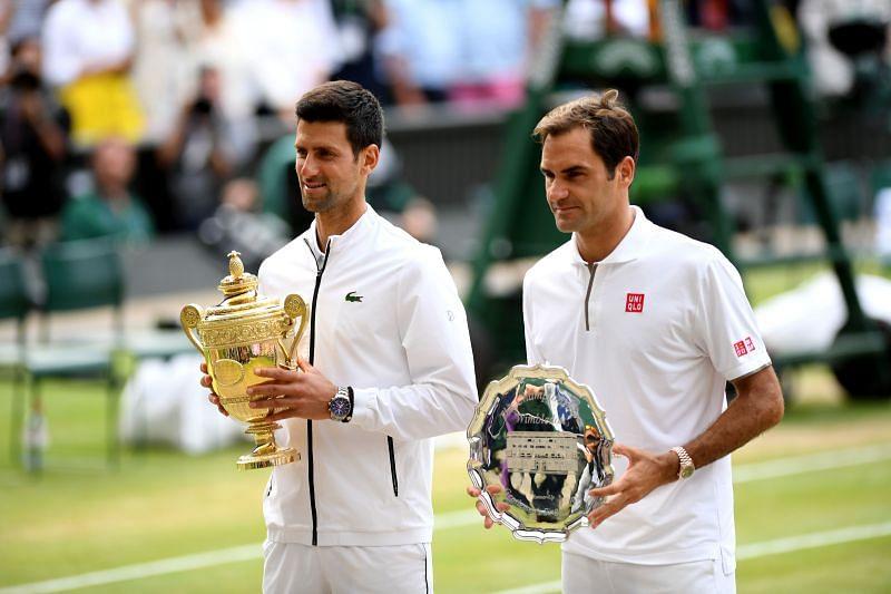 Novak Djokovic (L) and Roger Federer at Wimbledon 2019