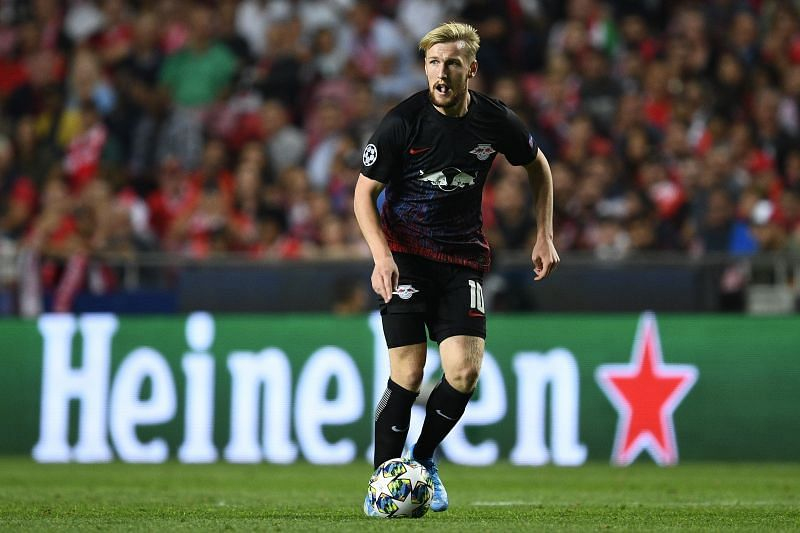 Two goals from Emil Forsberg sent RB Leipzig into the Champions League knockout stages for the first time after a comeback against Benfica