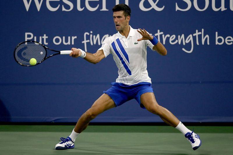 Novak Djokovic returns a shot at 2020 Western & Southern Open