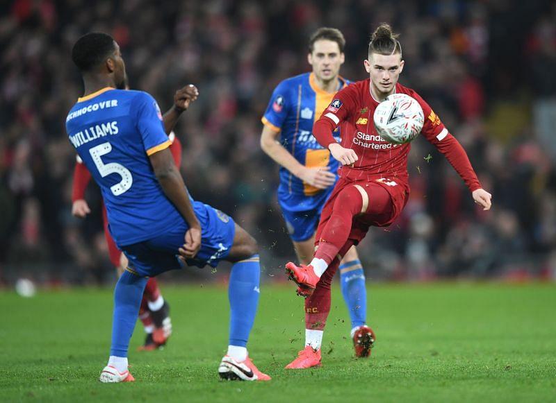 Harvey Elliott of Liverpool is challenged by Ro-Shaun Williams of Shrewsbury Town