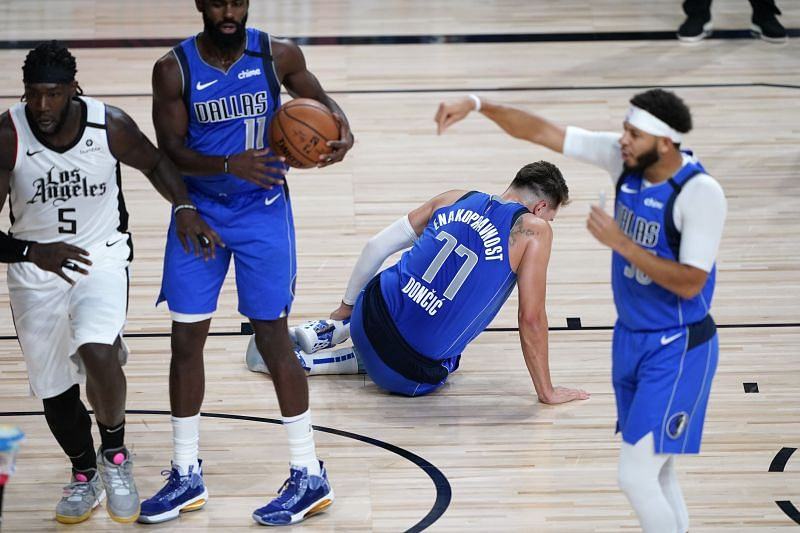 Luka Doncic holds his left ankle
