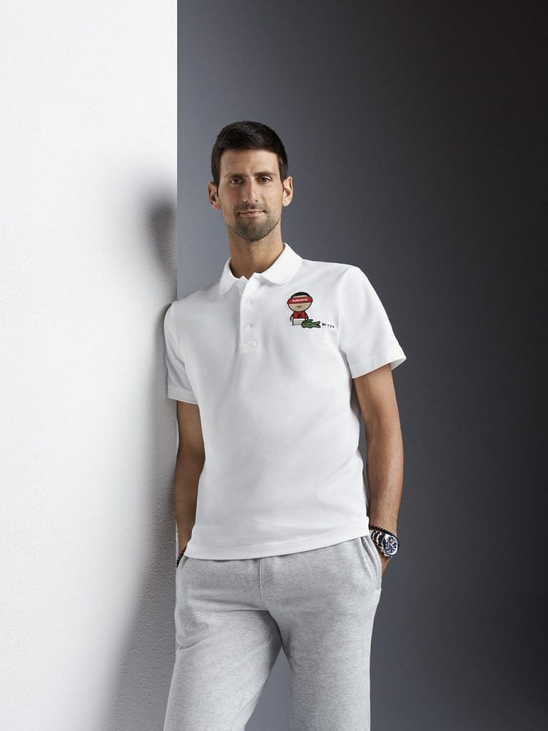 Novak Djokovic wearing a t-shirt with Sy