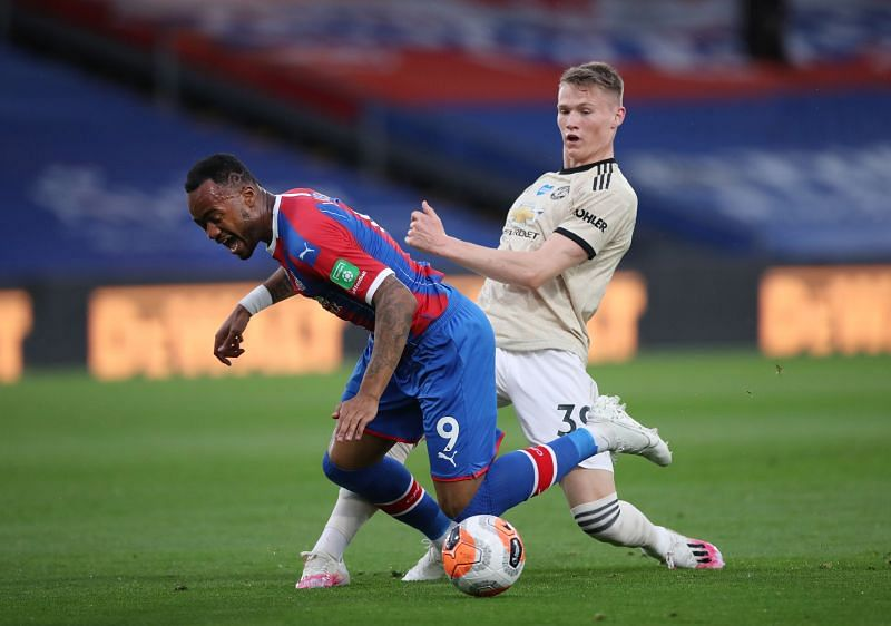 Jordan Ayew of Crystal Palace is tackled by Scott McTominay of Manchester United