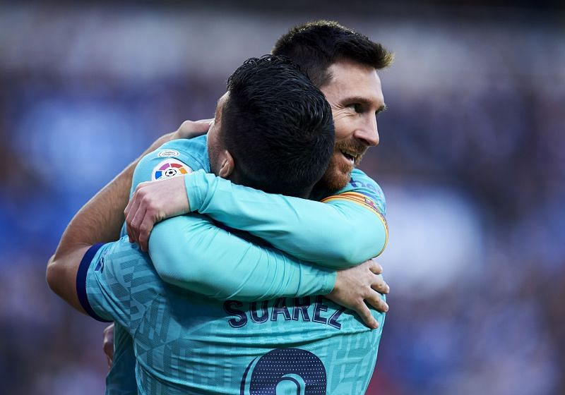 Suarez and Messi celebrating yet another goal