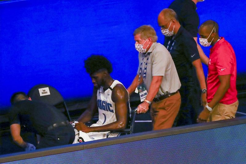 Jonathan Isaac being wheeled off the court