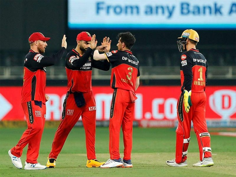 RCB players celebrate after the fall of a wicket. (Image Credits: Times of India)
