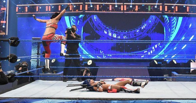 Bayley attacking Sasha Banks.