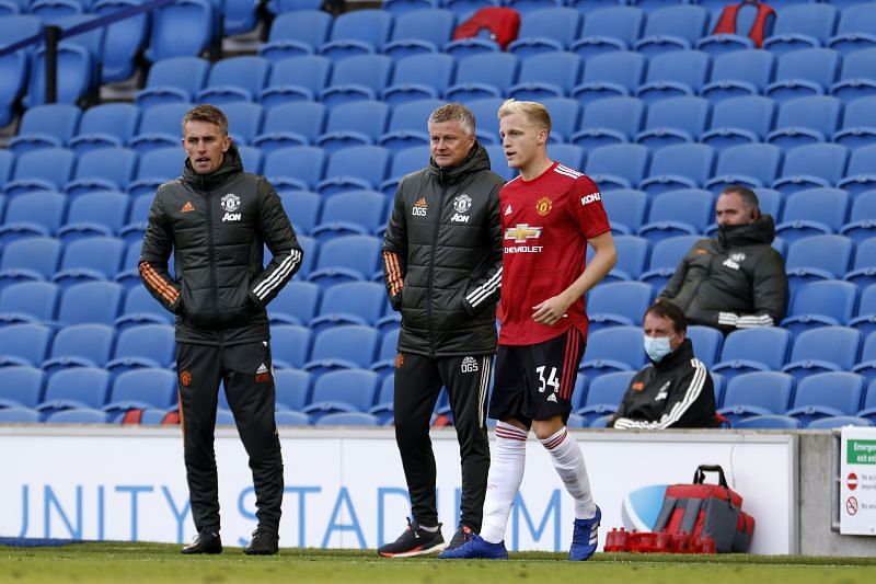 Ole Gunnar Solskjaer, manager of Manchester United speaks with Donny Van De Beek