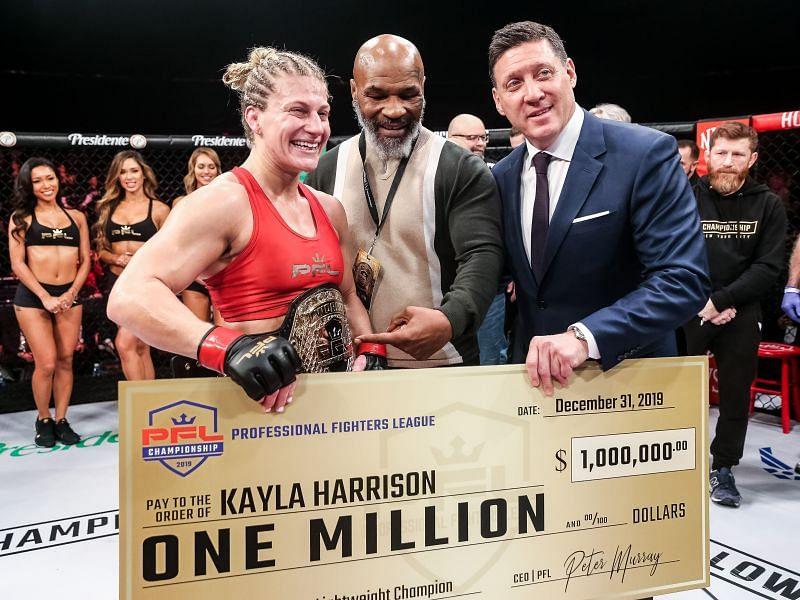 Mike Tyson handing the PFL 2019 Championship belt to Kayla Harrison