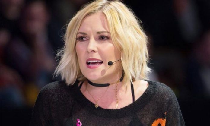 Renee Young looked quite thrilled to see FTR winning the Tag Team titles