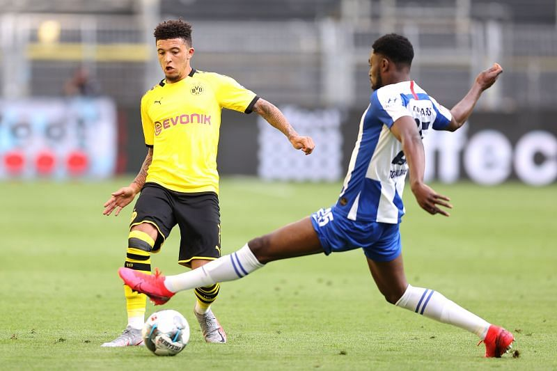Jadon Sancho of Borussia Dortmund battles for the ball