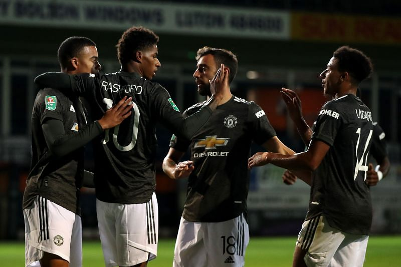 Manchester United celebrate after scoring their second goal of the game