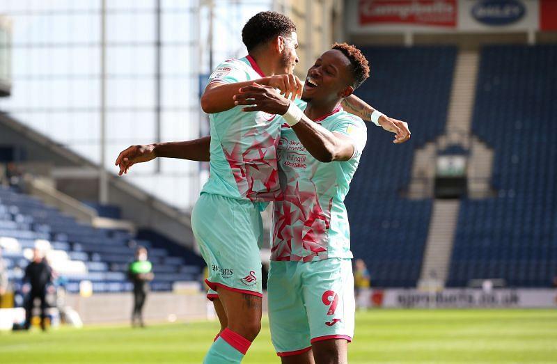 Morgan Gibbs-White (left) celebrates after scoring the winner for Swansea last weekend