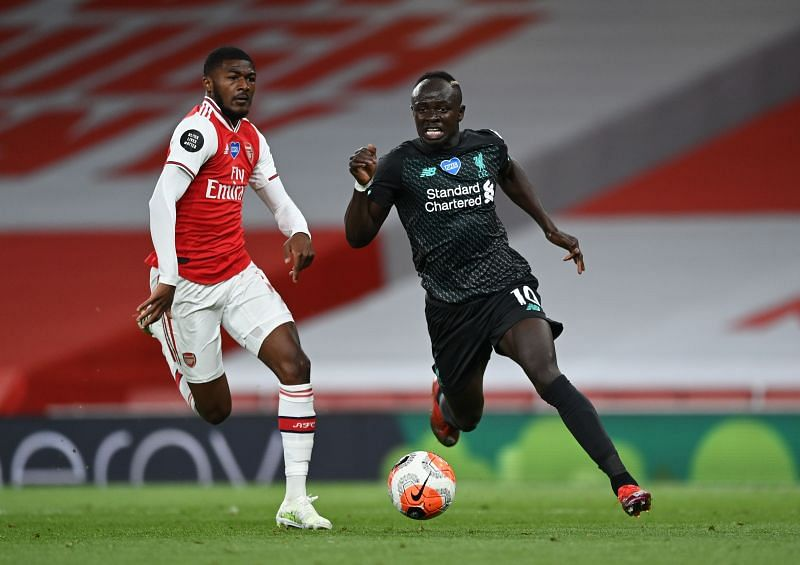 Sadio Mane of Liverpool breaks away from Ainsley Maitland-Niles (left) of Arsenal.
