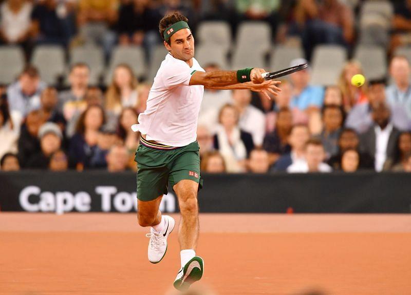 Roger Federer hits a running forehand