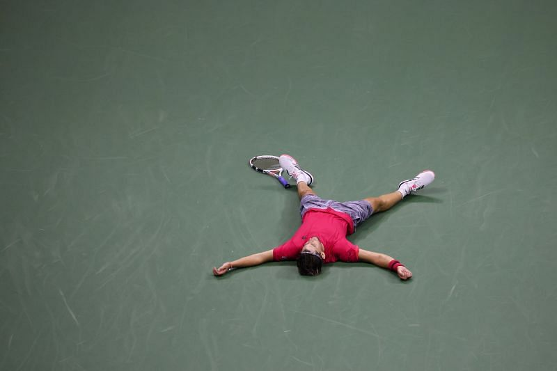 Dominic Thiem lays on the ground after winning his maiden Slam title.