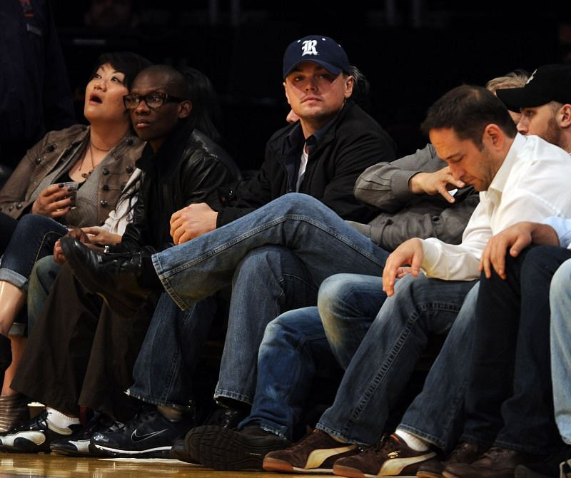Leonardo DiCaprio sitting courtside at Staples Center