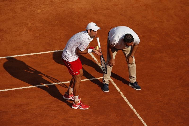 Novak Djokovic argues with the umpire over a line call in his semifinal match.