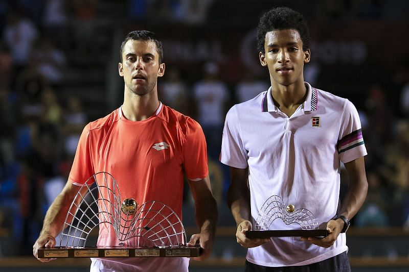 Felix Auger-Aliassime with the runner-up trophy alongside winner Laslo Djere at the ATP Rio Open 2019