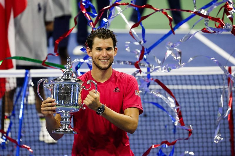 Dominic Thiem celebrates with the championship trophy at the 2020 US Open