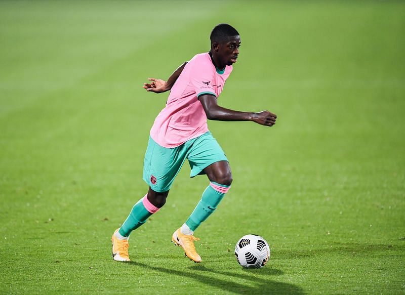 Ousmane Dembele of FC Barcelona runs with the ball during the during the pre-season