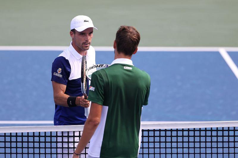 Daniil Medvedev and Roberto Bautista Agut after their match at the Cincinnati Masters