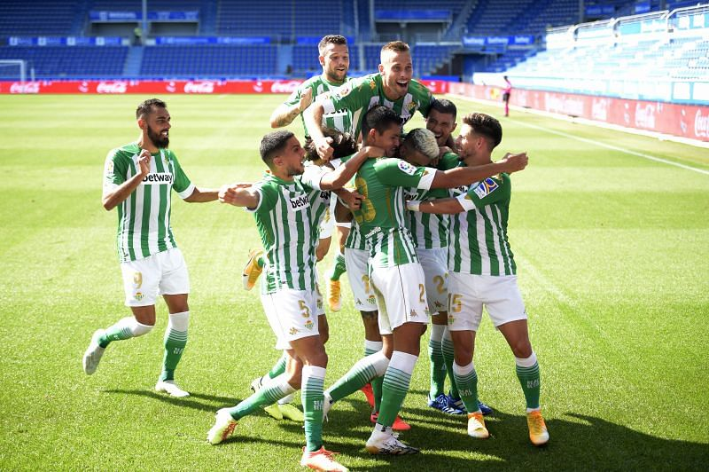 Real Betis players celebrate a goal against Alaves.