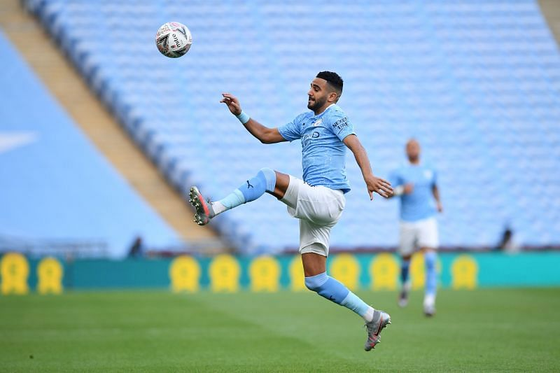 Riyad Mahrez of Manchester City controls the ball.
