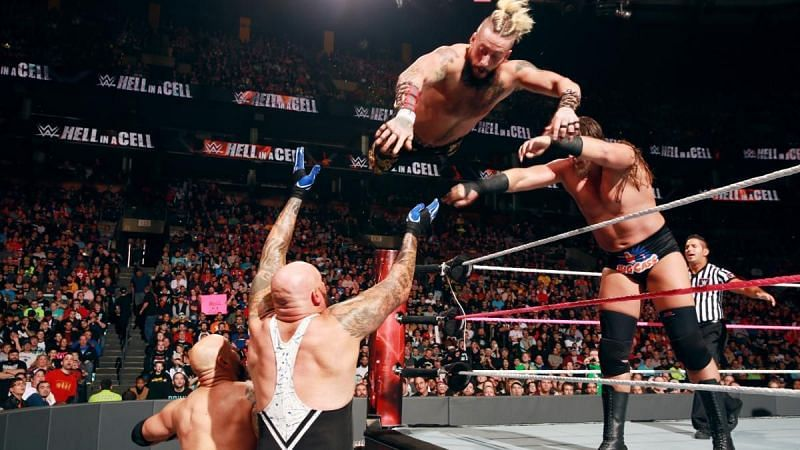 Enzo Amore wrestling with Gallows and Anderson in WWE