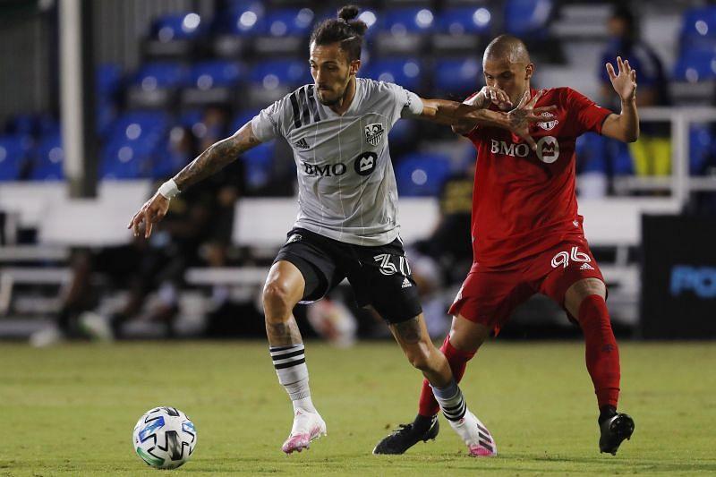 Maximiliano Urruti of Montreal Impact in action against Auro of Toronto FC